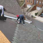 roofers_install_shingles